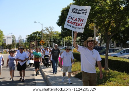 IRVINE, CALIFORNIA - June 30, 2018: Keeping Families Together. People march, hold signs, chant slogans, & protest to stop the administration from separating families who cross the boarder illegally.   #1124205329