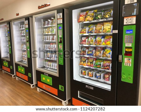 KOTA KINABALU,SABAH,MALAYSIA-July 1,2018: Seven 24  shop, First self-service convenience store in Malaysia. every item sold on a kiosk machine that can be purchased by cash money. #1124207282
