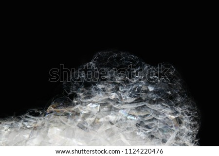 Soap bubble background / A soap bubble is an extremely thin film of soapy water enclosing air that forms a hollow sphere with an iridescent surface #1124220476