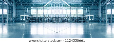 Slightly blurred and defocused background for your design. Piece of empty typical industrial space. Concept of manufacture, warehouse, storage, factory space. Copy space. Wide panoramic image.  Royalty-Free Stock Photo #1124335661
