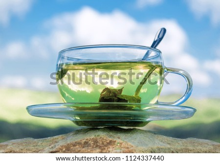 Green tea cup with green tea leaves. Tea time. #1124337440
