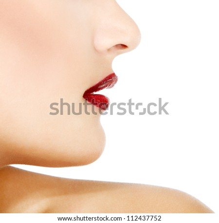 Face profile of young gorgeous fresh woman with vivid red lipstick, face detail. Isolated over white background #112437752