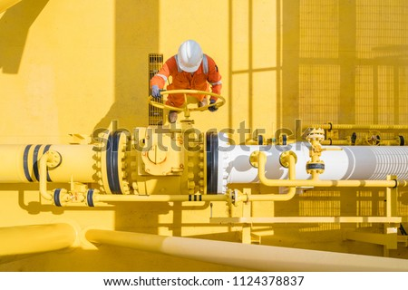 Offshore oil and gas site service operator open valve for control gases and crude product, Petroleum and chemical industry business. #1124378837