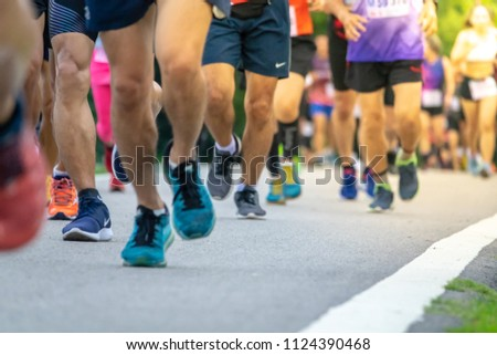 Chiang Mai, Thailand - June 17th, 2018 : Group of Chiang Mai people feet running in marathon running race on June 17th, 2018 in Chiang Mai Thailand #1124390468