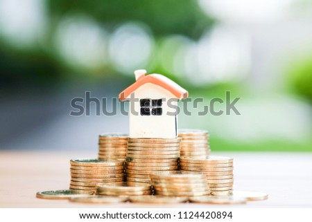 House model on coins stack. Risk, Assets, Property Investment. #1124420894
