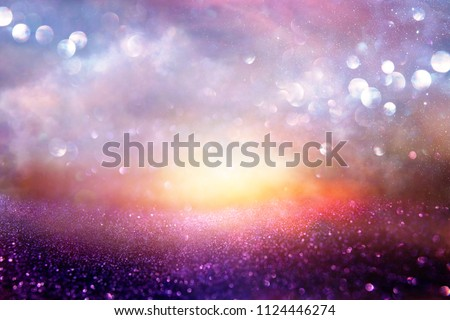 glitter vintage lights background. pink, blue, black and purple. de-focused #1124446274