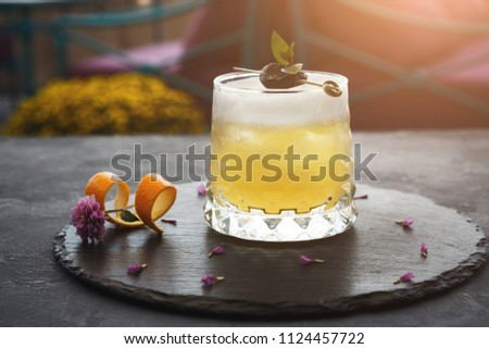 Cocktail on rustic wood background. Cold citrus alcohol beverage with tequila, blood juice and ginger beer, served with citrons and ice, copy space #1124457722