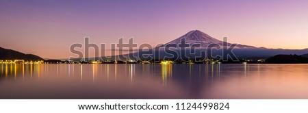 Aerial Panorama Landscape of Fuji Mountain. Iconic and Symbolic Mountain of Japan. Scenic Sunset Landscape of Fujisan at Evening Time, Kawaguchiko, Yamanashi, Japan. Royalty-Free Stock Photo #1124499824