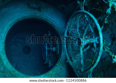 An underwater shot inside a room in the shipwreck of the Kittiwake that uses natural light as opposed to a strobe. The wreck has been sunk deliberately and is shallow enough to allow light penetration #1124500886