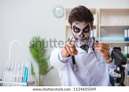 Scary monster doctor working in lab #1124605049