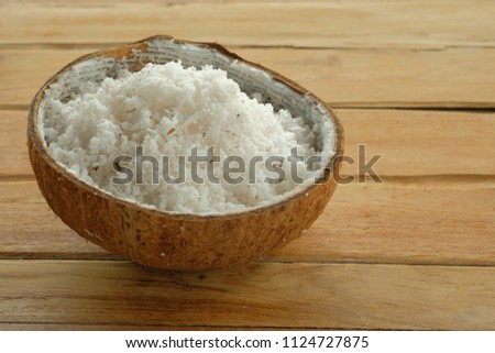 coconut powder on wood background #1124727875