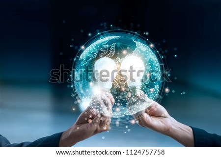 Business team holding circle global and light bulb on social media communication internet network connection and data exchanges worldwide, business networking and technology concept  #1124757758