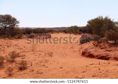 Finke, Northern Territory, Australia - June 9, 2018: Tatts Finke Desert Race track in Australian desert. Alice Springs to Finke and back. Royalty-Free Stock Photo #1124787611