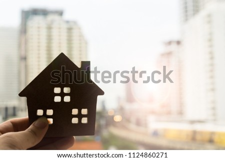 House model in home insurance broker agent 's hand or in salesman person. Real estate agent offer house, property insurance and security, affordable housing concepts #1124860271