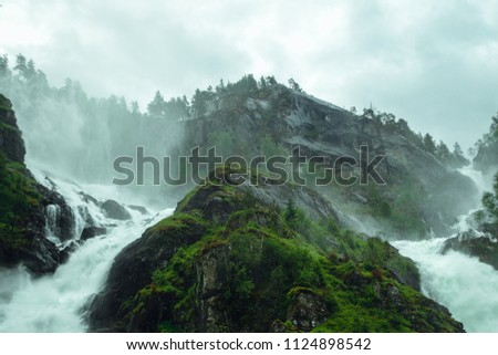 Amazing green nature in Odda small town between mountains and fjords in Norway #1124898542