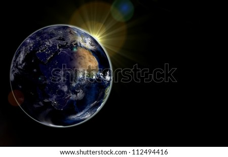 Earth with the rising sun. Day and night on the Earth. Elements of this image furnished by NASA #112494416