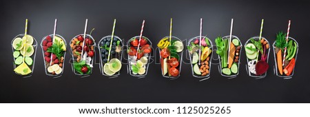 Food ingredients for blending smoothie or juice on painted glass over black chalkboard. Top view with copy space. Organic fruits, vegetables, nuts, seeds. Vegan, detox, clean eating concept. #1125025265