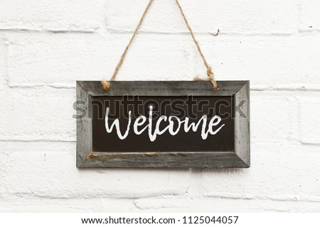 Chalkboard sign board with text welcome come in Royalty-Free Stock Photo #1125044057