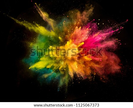 Colored powder explosion isolated on black background. Frozen motion. #1125067373