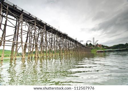 Wood bridge in the river, Sang Kha Buri in Thailand #112507976