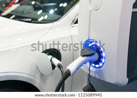 Charging modern electric car on the street which are the future of the Automobile #1125089945