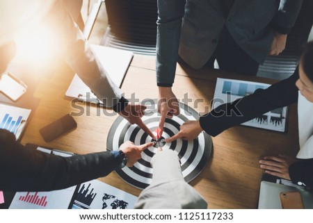 Businesspeople Point to a darts aiming at the target center business,Targeting the business concept. #1125117233