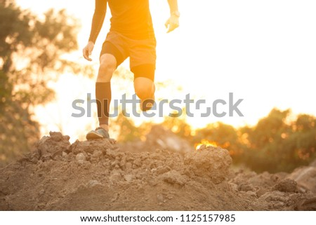 Trail running at the sunset #1125157985
