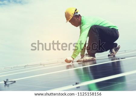engineer team working on replacement solar panel in solar power plant;engineer and electrician team swapping and install solar panel after solar panel voltage drop #1125158156