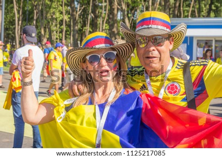 Russia, Samara, June 2018: cheerful painted football fans from Colombia rejoice at the FIFA World Cup. #1125217085