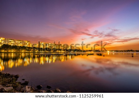 Sunset view of Bedok Reservoir, Singapore with colorful skyline and reflection #1125259961
