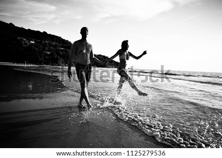 silhouettes of athletes running along the beach / sports summer in the warm sea, healthy rest, sports activity, summer vacation #1125279536