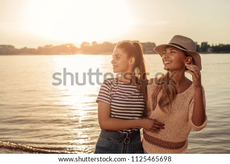 Shot of two young female friends having fun by the river #1125465698