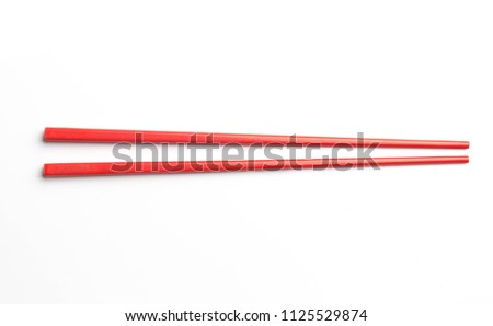 red chopsticks isolated on white background #1125529874