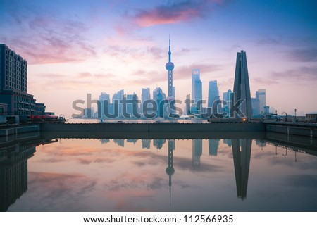 beautiful shanghai, rosy dawn reflection in the river #112566935