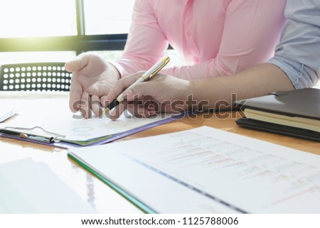 Administrator business man financial inspector and secretary making report, calculating or checking balance. - Business Concept #1125788006