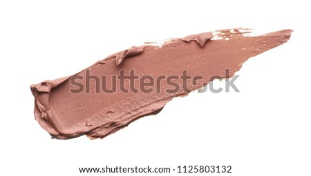 Light beige makeup smear of creamy foundation isolated on white background. Light beige creamy foundation texture background #1125803132