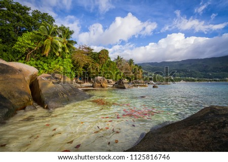 Formation of rocks and crystal clear water of Beau Vallon Beach, Seychelles #1125816746