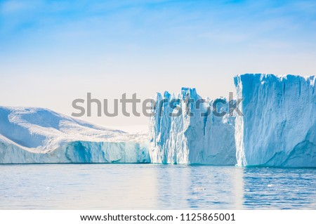 Big blue icebergs in Ilulissat icefjord, western Greenland #1125865001