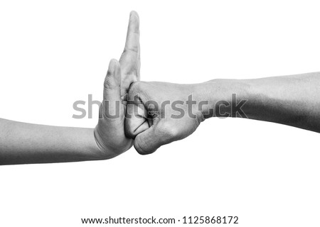 woman using hand palm to stop man's punch from attack isolated on white background. stop violence against women campaign concept with copy space, black and white color #1125868172