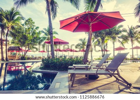 Beautiful luxury outdoor swimming pool with umbrella and chair in hotel and resort for travel and vacation #1125886676