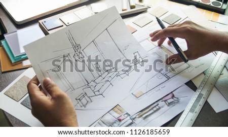 Architect designer Interior creative working hand drawing sketch plan blue print selection material color samples art tools Design Studio #1126185659
