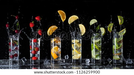 fresh cold drinks ice cream orange lime lemon strawberry cherry kiwi drop fall Royalty-Free Stock Photo #1126259900