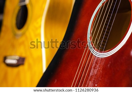 details of acoustic guitars are photographed close