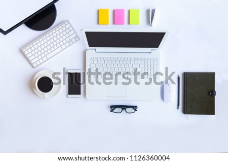 White desk office with laptop, smartphone and other work supplies with cup of coffee. Top view with copy space for input the text. Designer workspace on desk table essential elements on flat lay. #1126360004