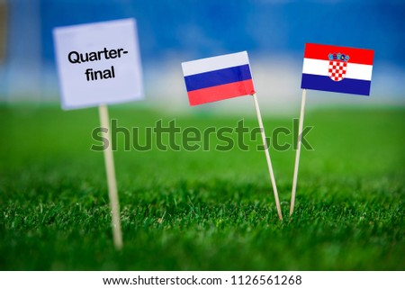 """Russia and Croatia national Flag on football green grass. White table with tittle """"QUARTER-FINAL"""" #1126561268"""
