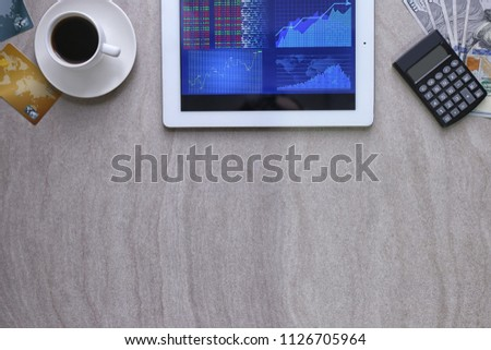 Tablet with stock data on table #1126705964