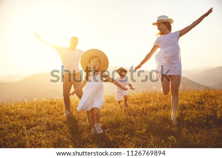 Happy family: mother, father, children son and  daughter on nature  on sunset #1126769894