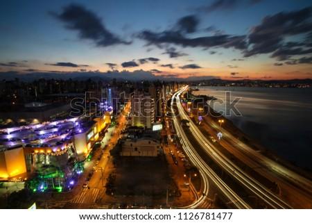 Florianopolis, Santa Catarina, Brazil. Long exposure photograph of night view of downtown and seashore at dusk. #1126781477