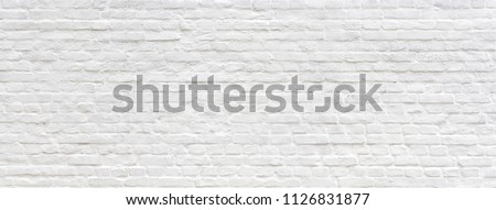 White brick wall texture panoramic . Home and office design backdrop. Painted bricks wall #1126831877