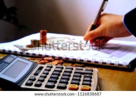 businessman   using  calculator to calculate the numbers on desk office, finance planning account idea concept.   #1126838687